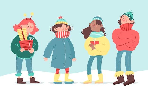 Vlakke mensen in winterkleren
