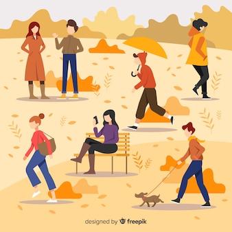 Vlakke mensen lopen in de herfst