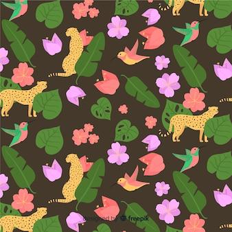 Vlakke tropische bladeren en bloemenachtergrond