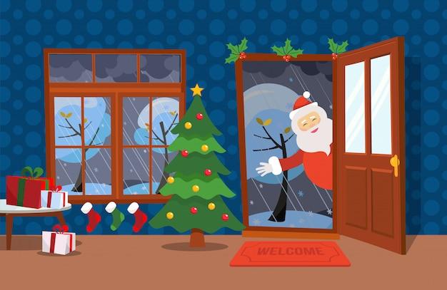 Vlakke wind illustratie cartoon stijl. open deur en raam met uitzicht op de met sneeuw bedekte bomen. kerstboom, tafels met cadeautjes in dozen en kerstsokken erin. santa claus kijkt in de deuropening