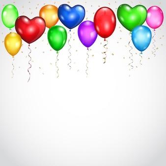 Vliegende gekleurde ballonnen en serpentines