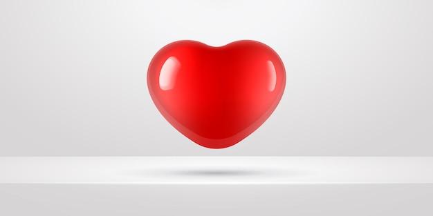 Vliegende rode ballon in hartvorm op witte achtergrond