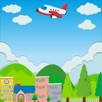 Vliegtuig dat over gebouwen in voorstad vliegt