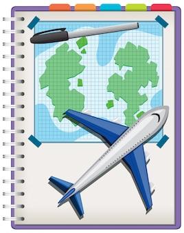 Vliegtuig en pen op notitieboekje dat op witte achtergrond wordt geïsoleerd