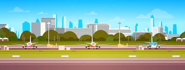 Vliegtuigen over luchthavengebouw