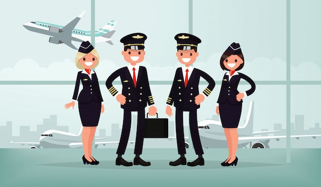 Vliegtuigpersoneel. de bemanning van de civiele vliegtuig in het luchthavengebouw. piloten en stewardessen.