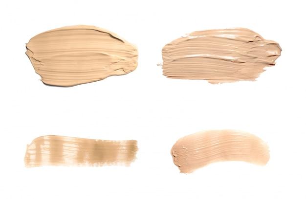 Vloeibare foundationtint vlek. set concealer uitstrijkje cosmetische crème geïsoleerd