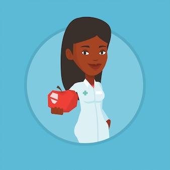 Voedingsdeskundige met verse rode appel.