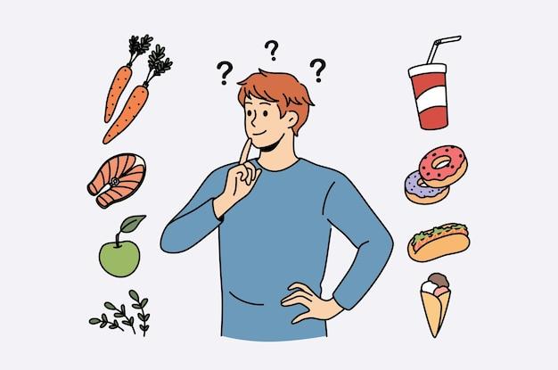 Voedsel en dieet keuze concept. jonge lachende man stripfiguur die probeert te kiezen tussen gezond voedsel en vet junk fastfood