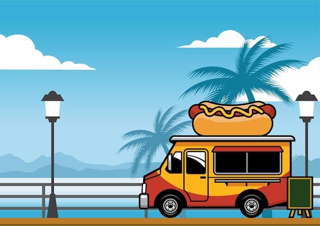 Voedselvrachtwagen die hotdog op het strand verkoopt