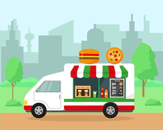 Voedselvrachtwagen in stadspark. snel voedselconcept. lente of zomer stadsgezicht achtergrond afbeelding.