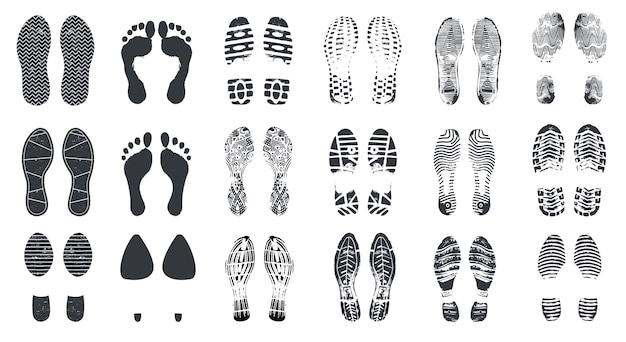 Voetafdruk silhouetten. op blote voeten, sneaker en schoenen treden met vuiltextuur. wandelschoen voetafdrukken, voetafdrukken vector geïsoleerde set