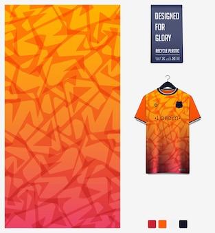 Voetbal jersey stof patroon ontwerp abstract patroon op oranje achtergrond
