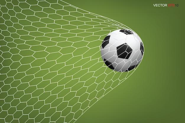 Voetbal voetbal in doel en wit net