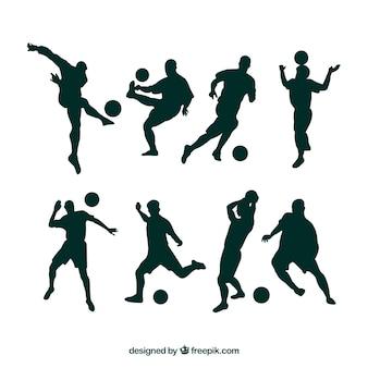 Voetballers silhouetten in verschillende posities