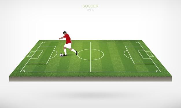 Voetbalspeler en voetbalvoetbalbal op gebied van voetbalgebied met witte achtergrond.