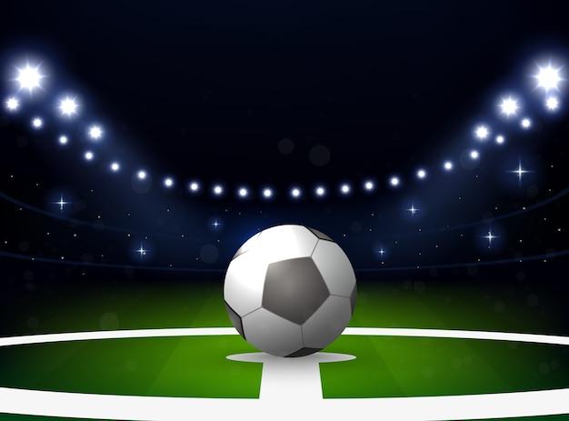 Voetbalstadion met bal en schijnwerper 's nachts