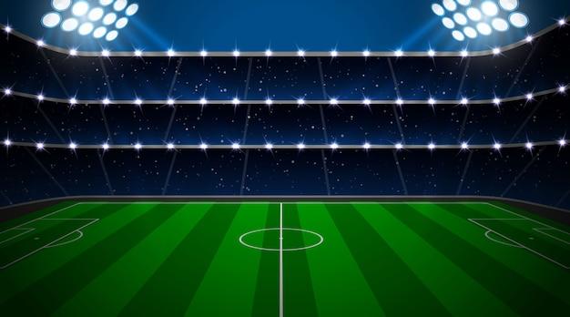 Voetbalstadion met groen veld.
