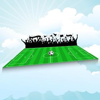Voetbalveld achtergrond met juichende menigte tegen een blauwe hemel