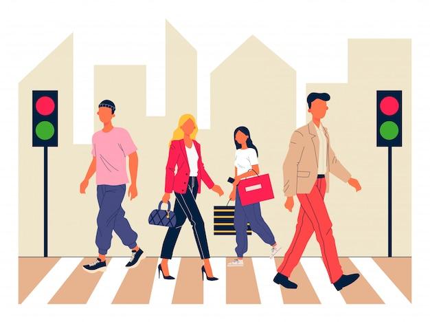 Voetgangers die stadsstraat kruisen