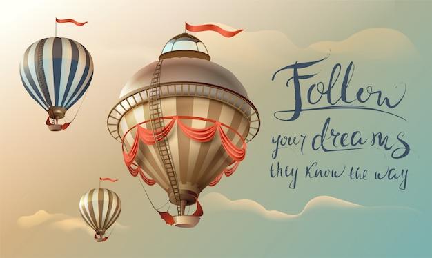 Volg je dromen, zij weten de weg. zin citaat handgeschreven tekst en ballonnen in de lucht