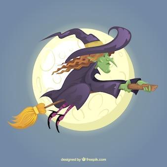 Volle maan en heks die op bezem vliegen