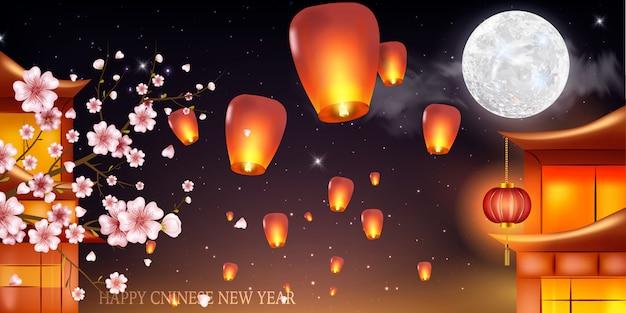Volle maanachtergrond voor traditioneel van chinees medio autumn festival of lantaarnfestival -. chinese lantaarns in de nachtelijke hemel.
