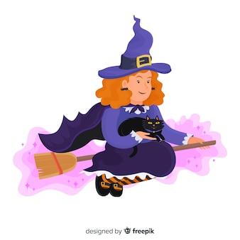 Volwassen halloween-heks die een zwarte kat houdt