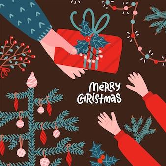 Volwassen menselijke handen met kerst rode geschenkdoos. armen geven geschenkdoos aan kind