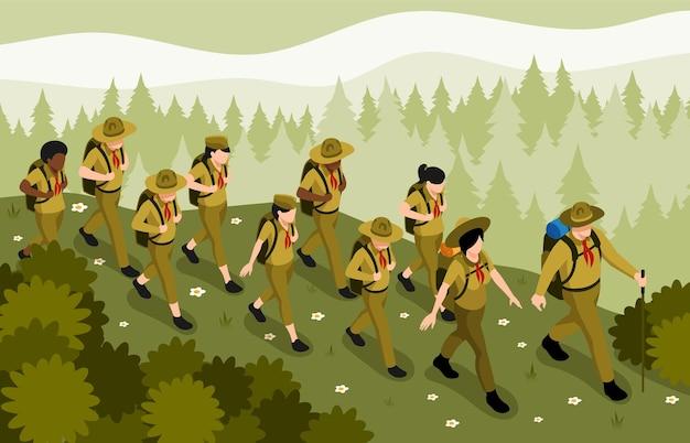Volwassen mentoren die padvindersgroep begeleiden bij het wandelen in de wilde bosnatuur