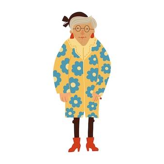 Volwassen senior zelfverzekerde dame die lichte kleding en accessoires draagt, oude volwassen vrouw die staat
