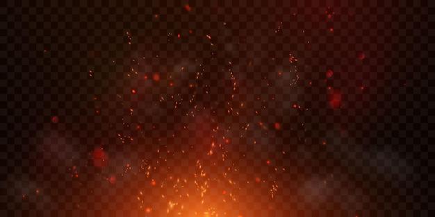 Vonken vliegen omhoog gloeiende deeltjes en met vlammen