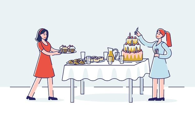 Voorbereiding van de verjaardagsviering met twee vrouwen die vakantie zoete tafel serveren