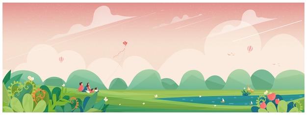 Voorjaar. familie-uitje naar het park of picknick op het platteland met vlieger, bloemenbloesem en herten. concept van mensen in de lente.