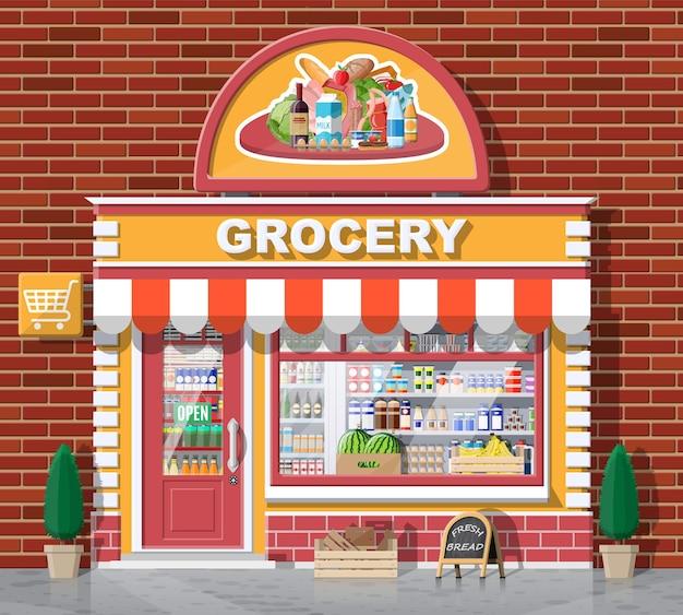 Voorkant van de supermarkt met raam en deur