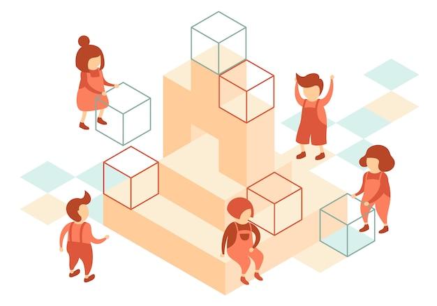 Voorschoolse kinderen gebruiken kubussen om op de speelplaats te spelen