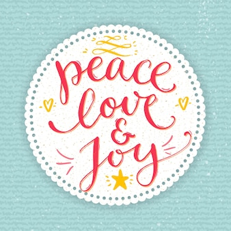 Vrede, liefde en vreugde tekst. kerstkaart met aangepast handgeschreven type, vectorpuntpenkalligrafie. rode zin in ronde frame op blauwe gebreide textuur achtergrond.