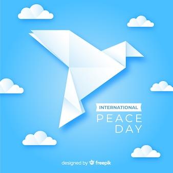 Vredesdag concept met origami duif