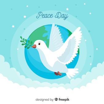 Vredesdag met duif plat ontwerp