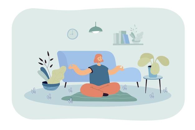 Vreedzame vrouw doet yoga thuis vlakke afbeelding