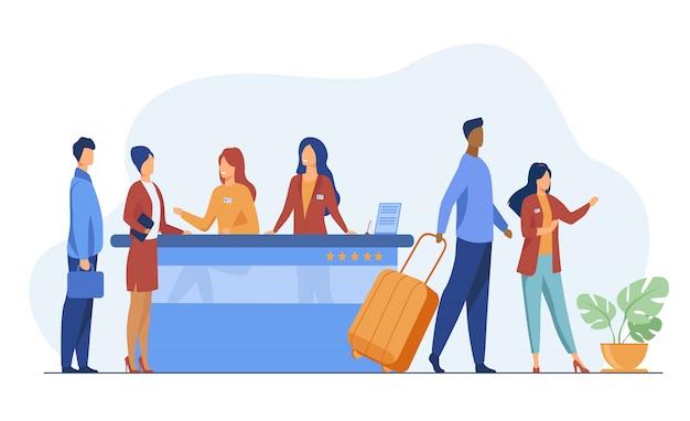 Vriendelijke receptionisten van de registratiebalie van het hotel helpen klanten