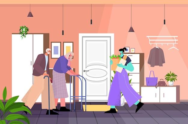 Vriendelijke verpleegster of vrijwilliger die voedsel brengt aan senior paar thuiszorgdiensten gezondheidszorg en sociale ondersteuning concept woonkamer interieur horizontale volledige lengte vectorillustratie