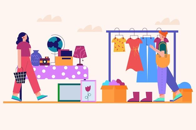 Vrienden die kleren op rommelmarkt verkopen