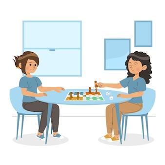 Vrienden spelen ludo-spel aan tafel