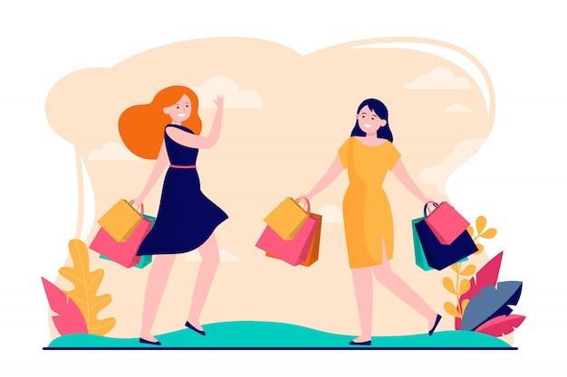 Vriendinnen genieten van samen winkelen