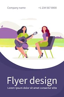 Vriendinnen ontspannen aan het meer. vrouwen gitaar spelen en zingen buiten platte flyer-sjabloon