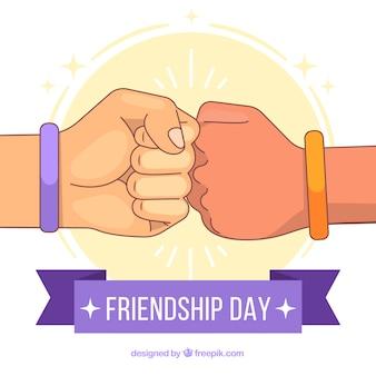 Vriendschapsdag achtergrond met handen