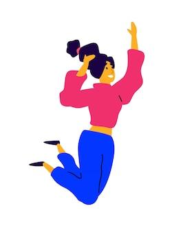 Vrolijk dansend meisje in een roze trui en blauwe broek.