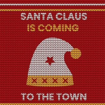 Vrolijk gebreid patroonontwerp van de kerstmis rode kleur met de hoed van de kerstman