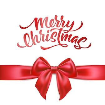 Vrolijk kerstfeest belettering met realistische rode strik met zijde rood lint